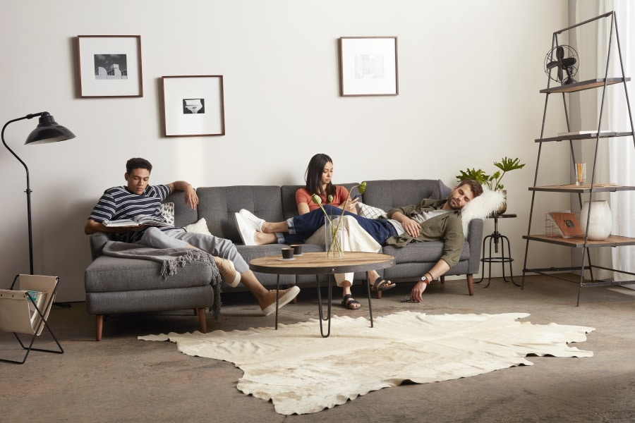 men and women sitting on burrow couch pad
