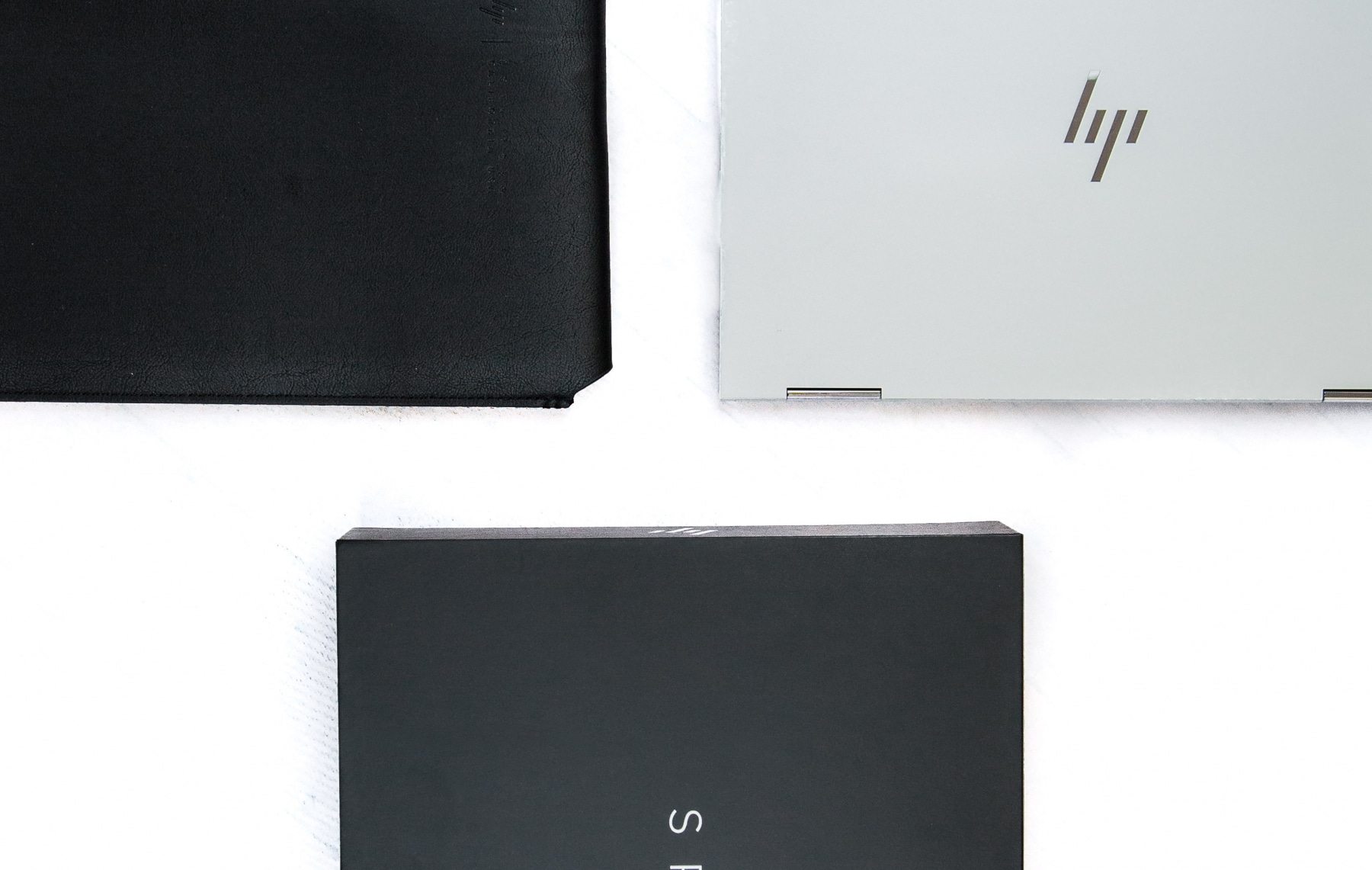 hp spectre x360 convertible laptop and leather box