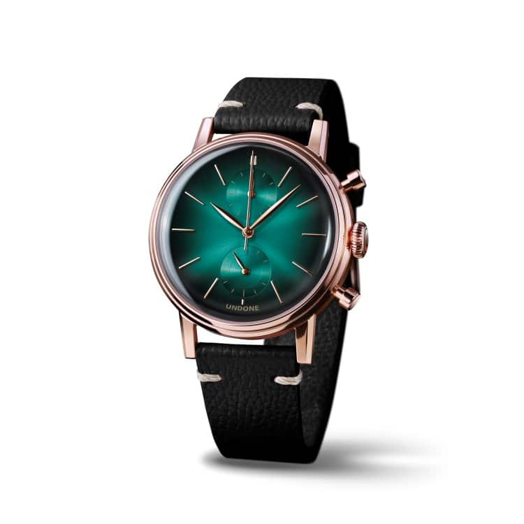 undone wrist watch with black leather belt