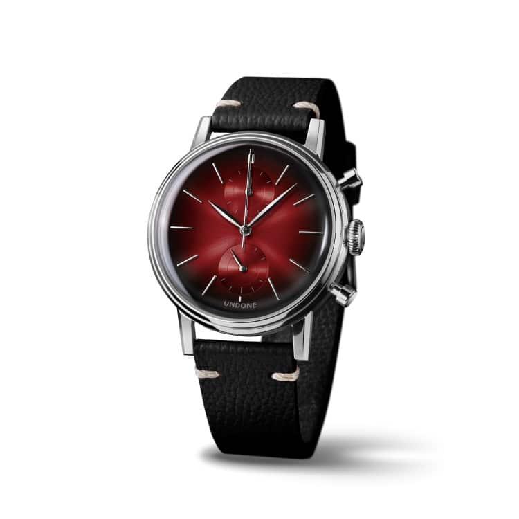 undone wrist watch with black belt