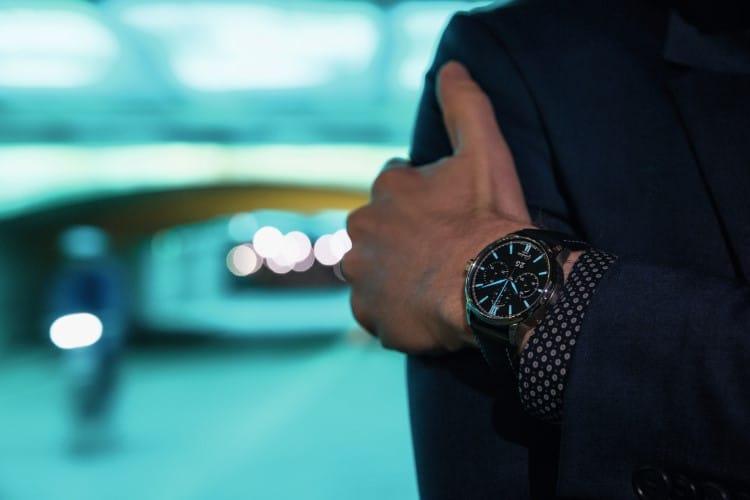wearing glashütte original watch hand on the blazer
