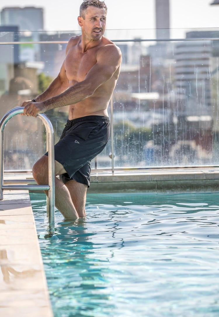 man standing on a stair swimming pool