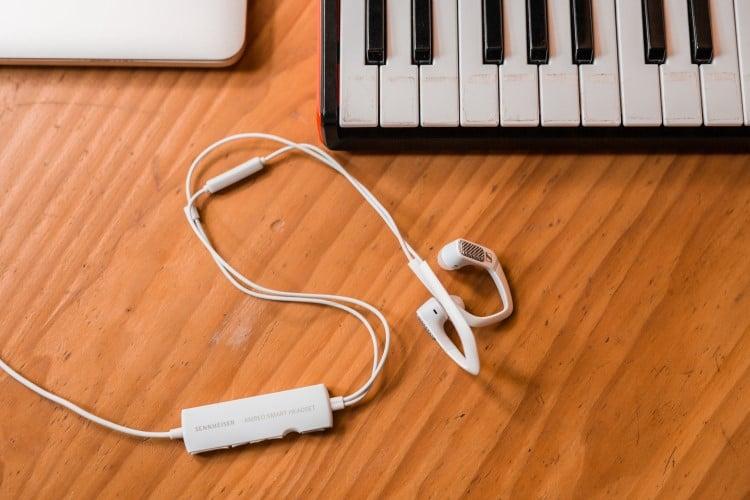 sennheiser ambeo smart headset beside the piano